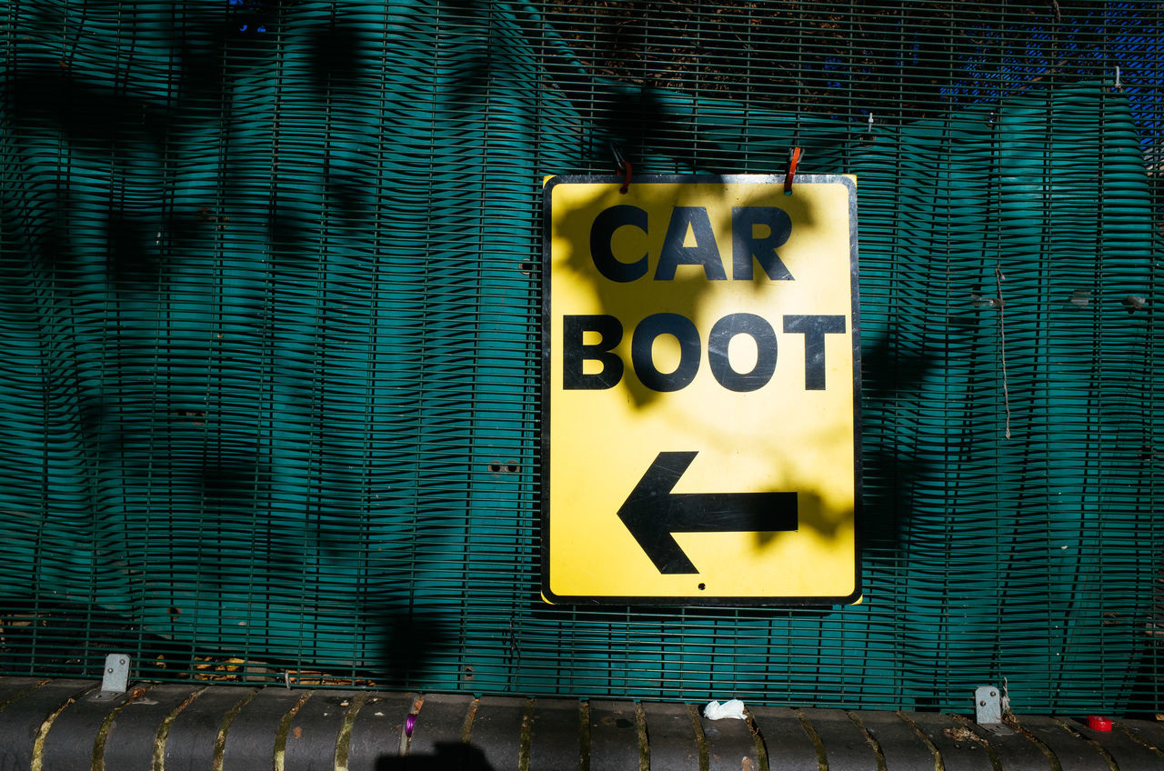 Arrow Boot Car Car Boot Communication Community Day Direction Entrance Event Local Market No People Outdoors Sale Second Hand Sign Text Vintage Yellow
