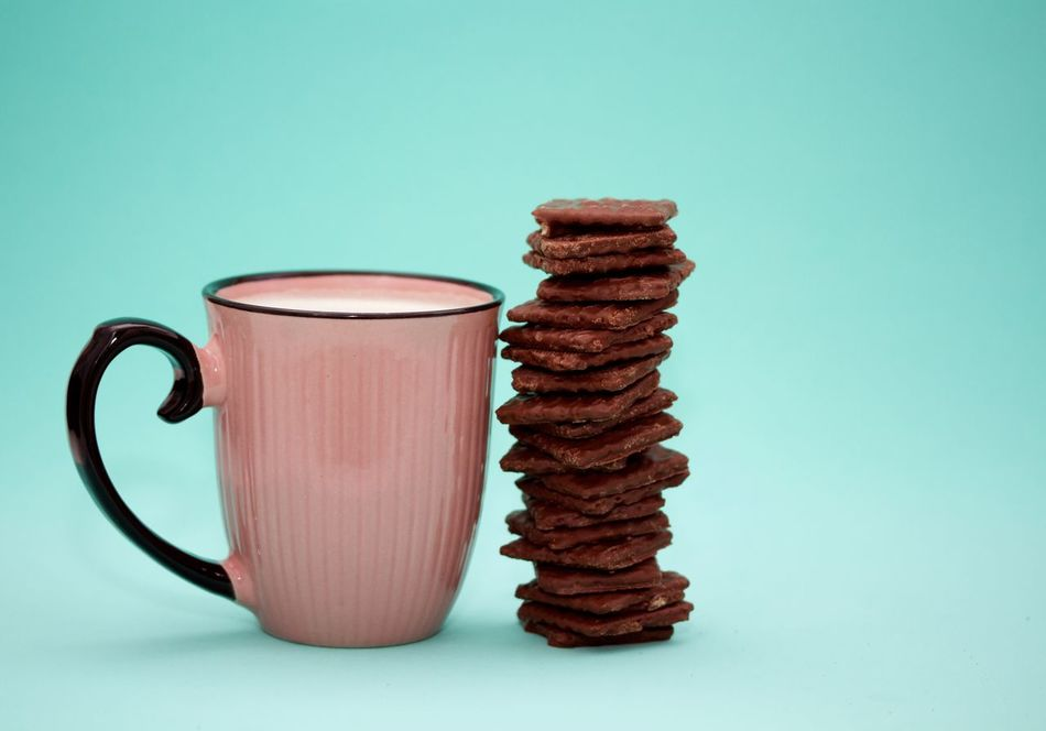 Pink mug of coffee and a huge stack of chocolate biscuits on green background Blue Background Chocolate Coffe Cookie Food Food And Drink Gourmet Indoors  No People Pink Cupcakes Pink Mug Ready-to-eat Snack Stack Studio Shot Sweet Food