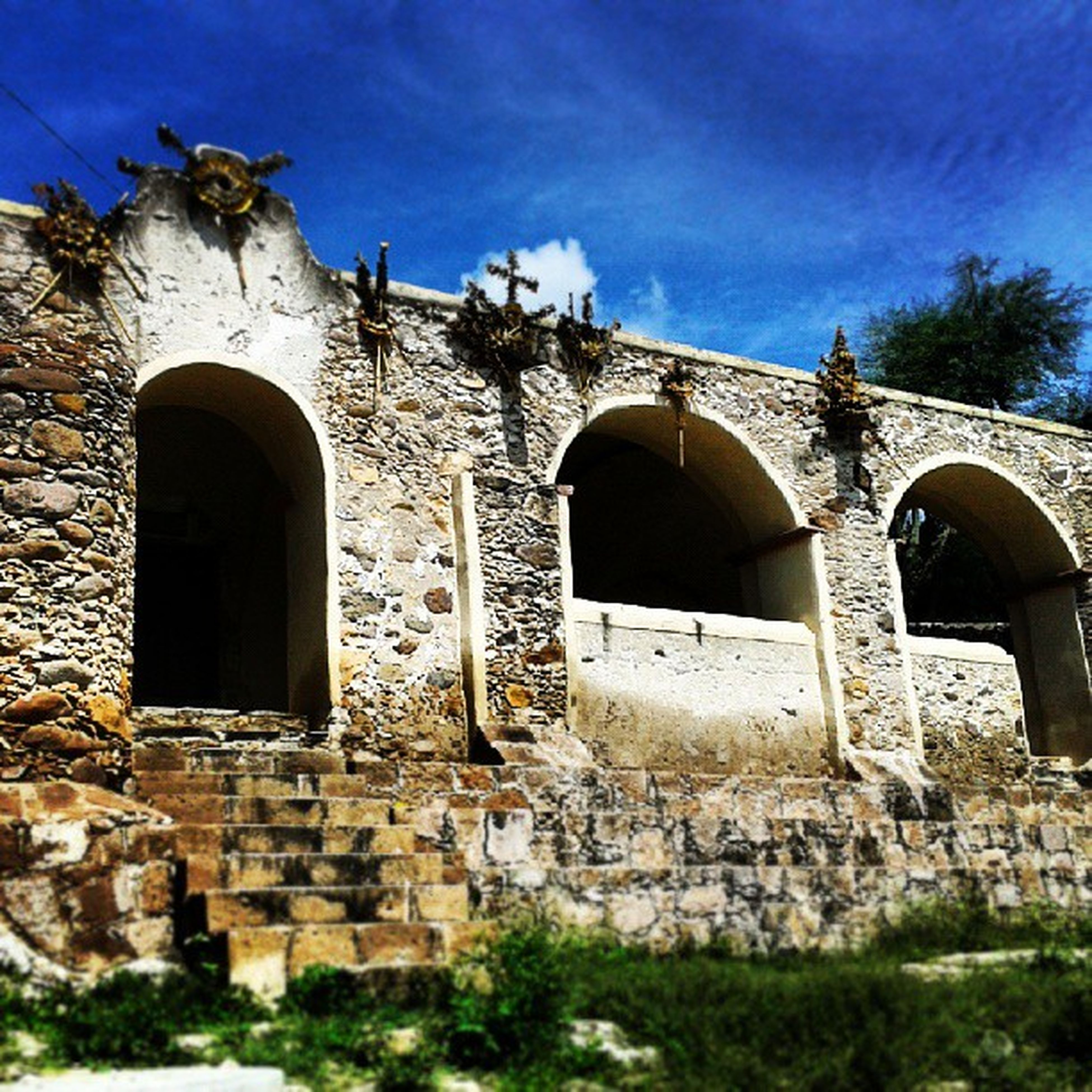 architecture, built structure, building exterior, old, abandoned, old ruin, damaged, obsolete, history, run-down, deterioration, arch, weathered, low angle view, stone wall, sky, ruined, the past, bad condition, window