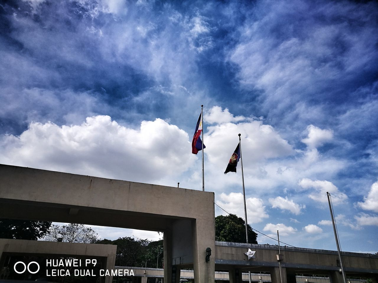 flag, patriotism, sky, cloud - sky, low angle view, day, outdoors, built structure, architecture, no people