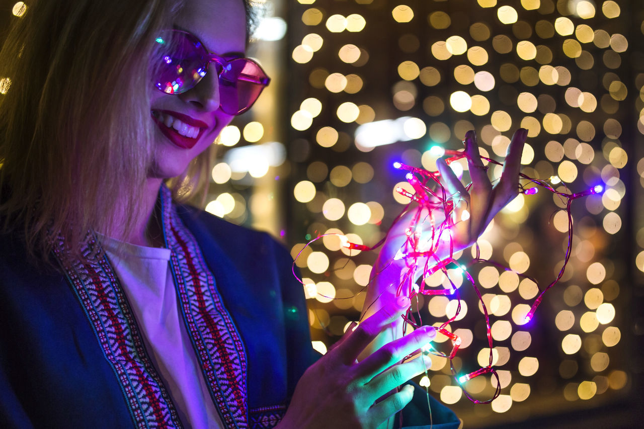 Bokeh Celebration Christmas Christmas Decoration Christmas Lights City Happiness Illuminated Lifestyle Lights Millennial Pink Neon Night Nightlife One Person Polka Dot Purple Smiling Women Young Adult