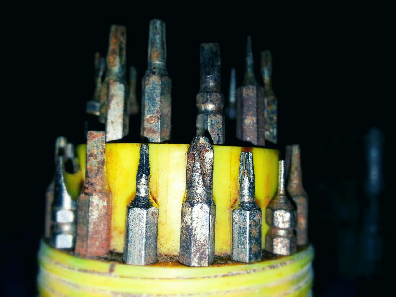 In A Row Indoors  No People Black Background Close-up Filament Screwdrivers Set Of Screwdriver Iron - Metal Container Circle Table EyeEm Best Shots Creative Light And Shadow Rusty Metal Yellow