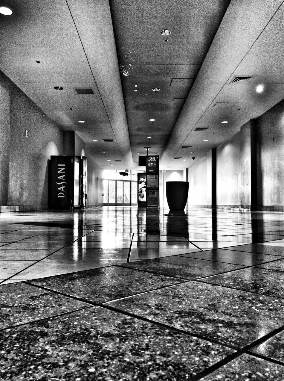 Nostalgic  Mall Shopping Time Glow Shopping Mall Indoors  Reflection Tiled Floor Built Structure Architecture No People Illuminated Day Phoenix Arizona Metrocenter Eye For Photography Atmosphere Darkness And Light Modern Indoors  Architecture The Way Forward Blackandwhite Hallway