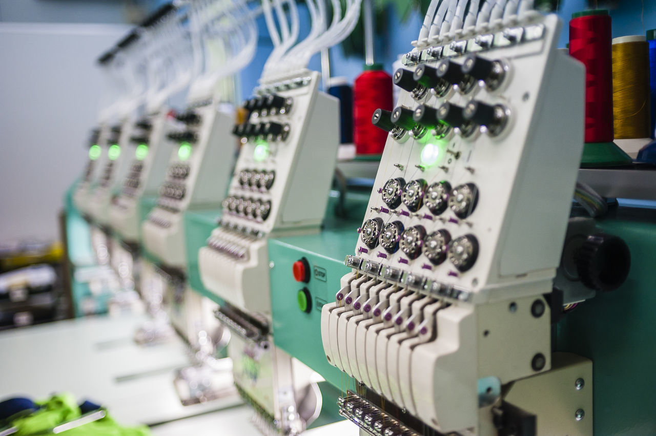 Business Close-up Embroidery Focus On Foreground Industrial Industry Machinery Machines Objects Printing Selective Focus Sewing Machine Still Life Textile Threads Close Up Technology