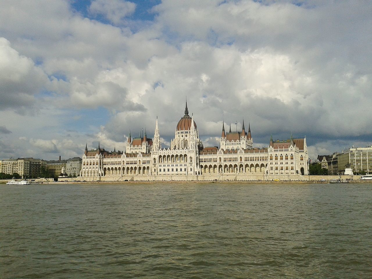 Budapest, Hungary Parliament House Clouds And Sky Danube River
