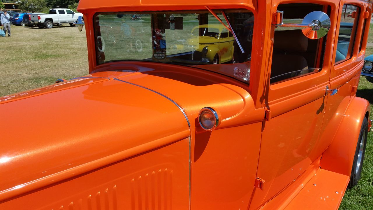land vehicle, transportation, mode of transport, orange color, car, day, outdoors, no people, red, close-up