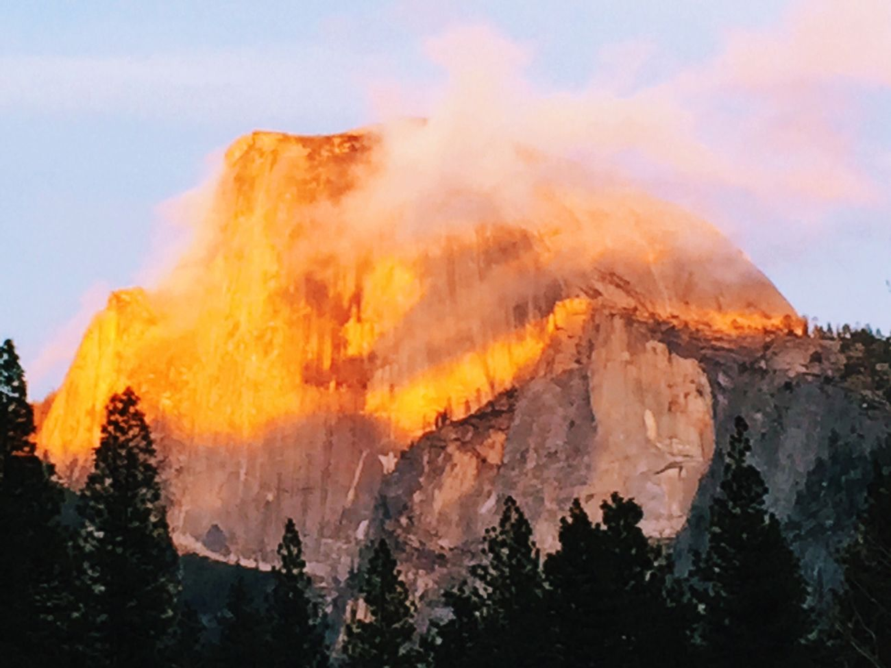 Half Dome glowing golden with the setting sun at Yosemite National Park Vscocam Yosemite IPhoneography Nature Landscape Sunset Travel Holiday Spring VSCO