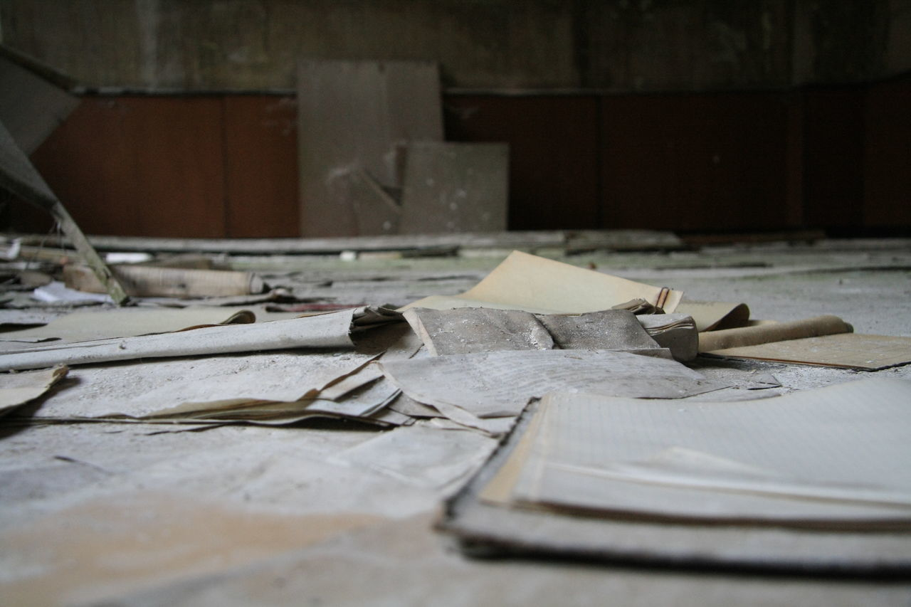 Close-Up Of Messy Papers In Abandoned Building Room