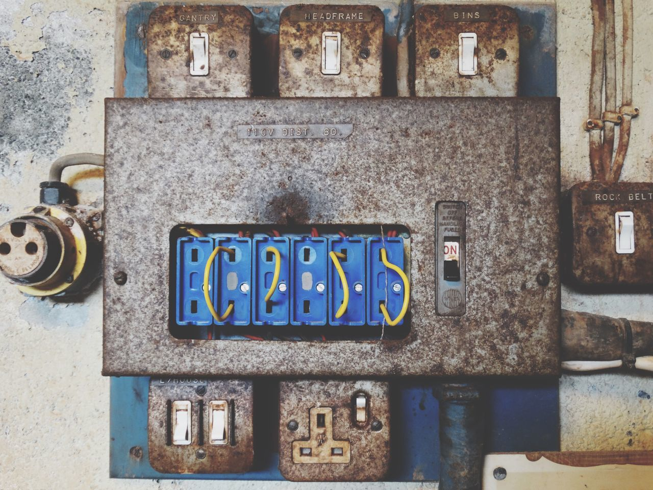 Circuitry. Communication No People Outdoors Day Text Building Exterior Built Structure Textured  Brick Wall Architecture Close-up Circuit Circuit Board Machinery Technology Switches Switch Electricity  Dark Old Rusty