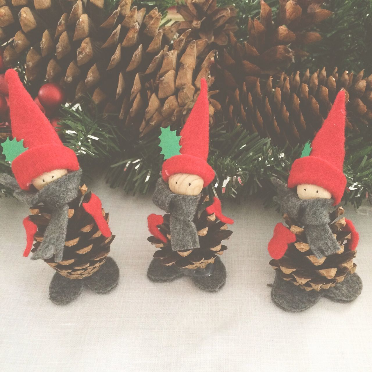 Christmas Christmas Decoration Close-up Celebration No People Day Pinecone Craft Christmas Ornament Elf Holiday Red Hat Cute Christmas Wintertime Decoration Evergreen