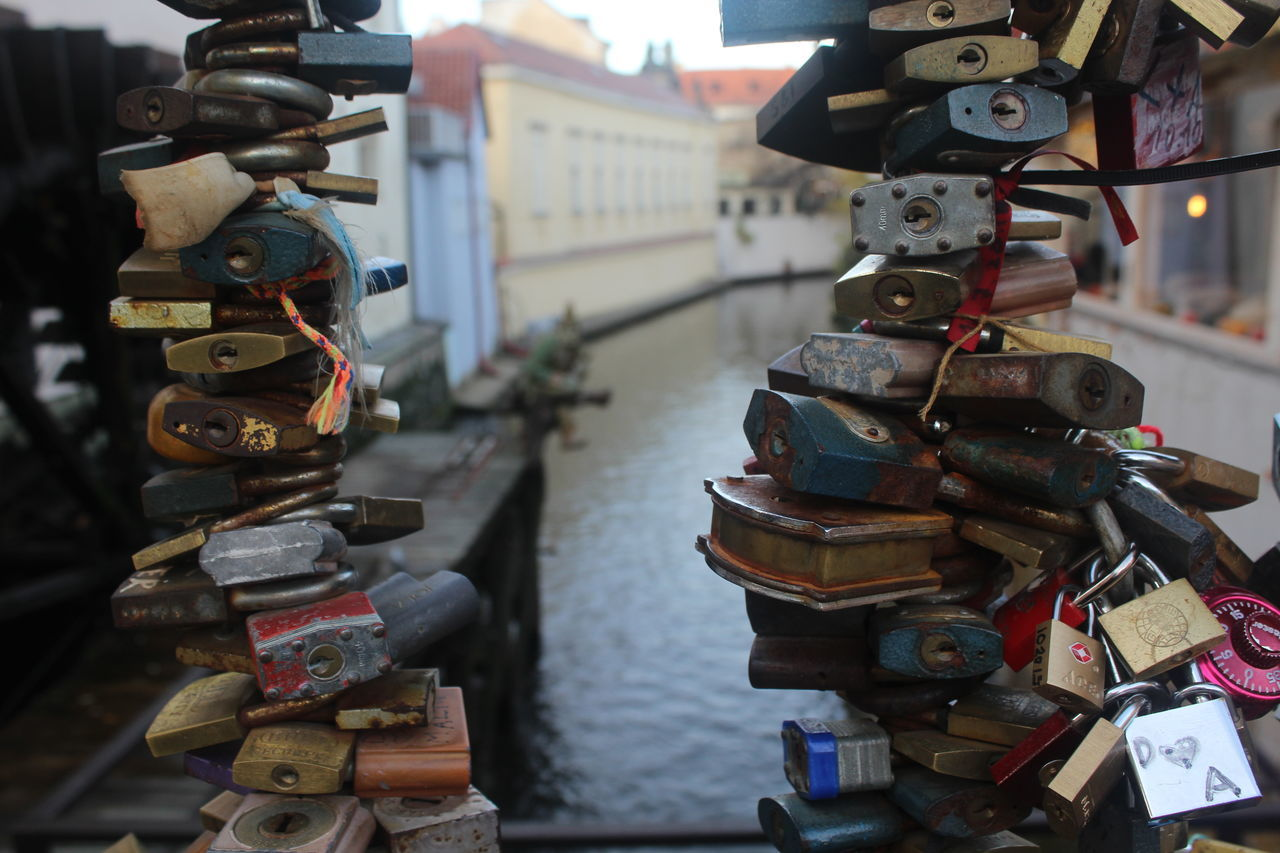 Padlocks Attached In Railing Above Canal