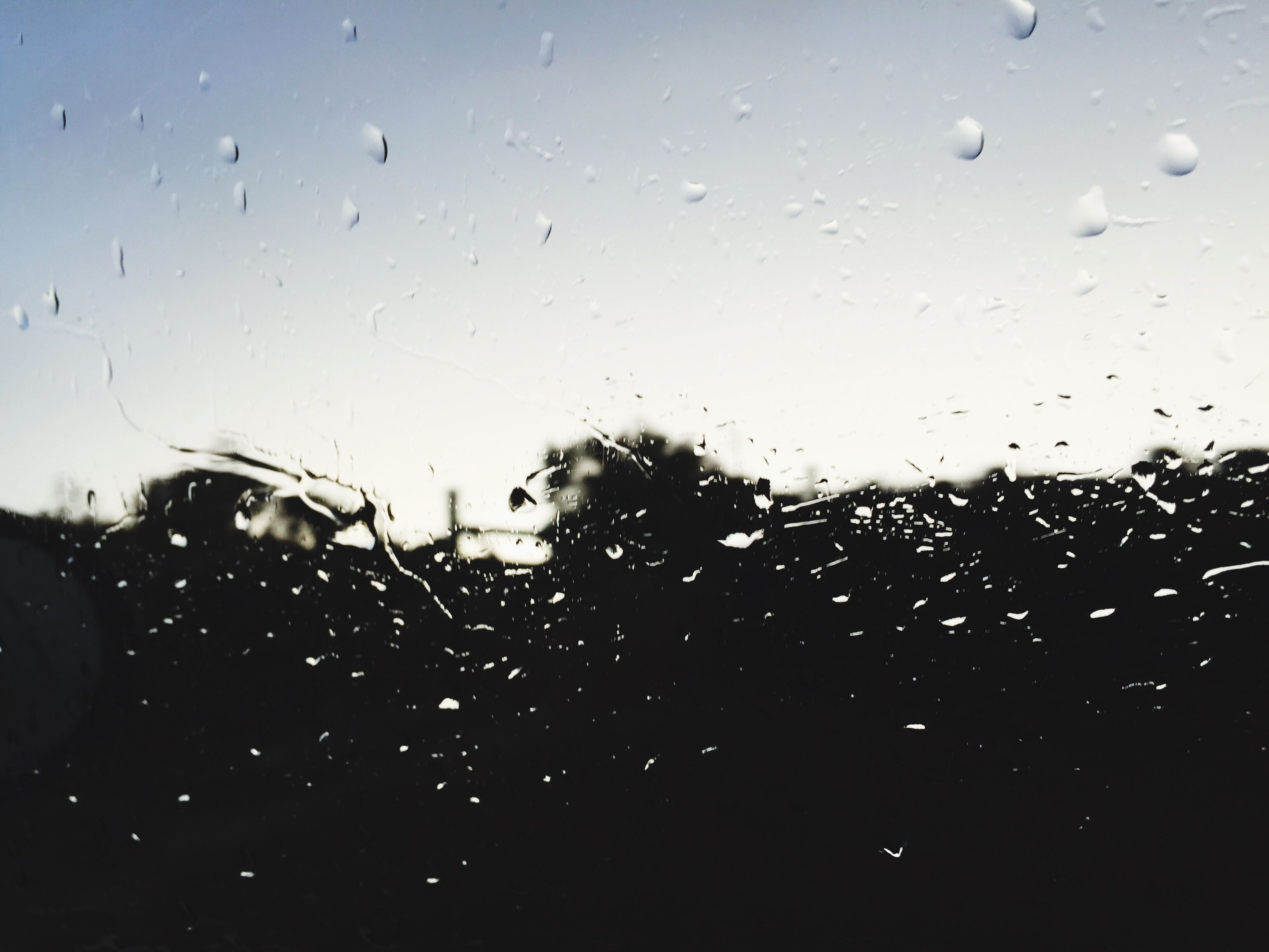 drop, wet, rain, window, transparent, glass - material, raindrop, indoors, water, weather, season, car, sky, transportation, vehicle interior, glass, full frame, backgrounds, mode of transport, focus on foreground