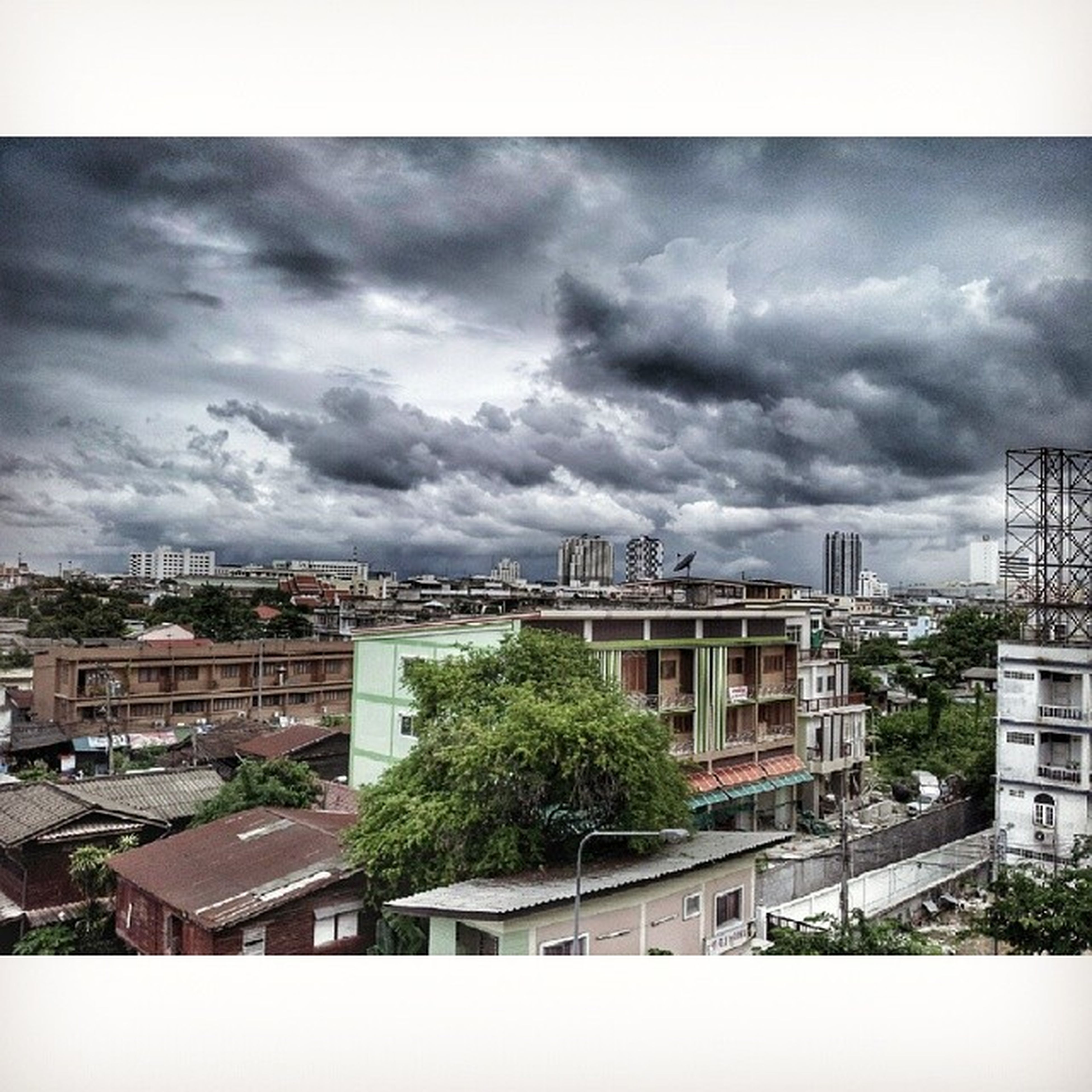 architecture, building exterior, built structure, sky, transfer print, cloud - sky, city, cloudy, auto post production filter, cityscape, cloud, overcast, residential building, tree, residential district, weather, residential structure, storm cloud, building, outdoors