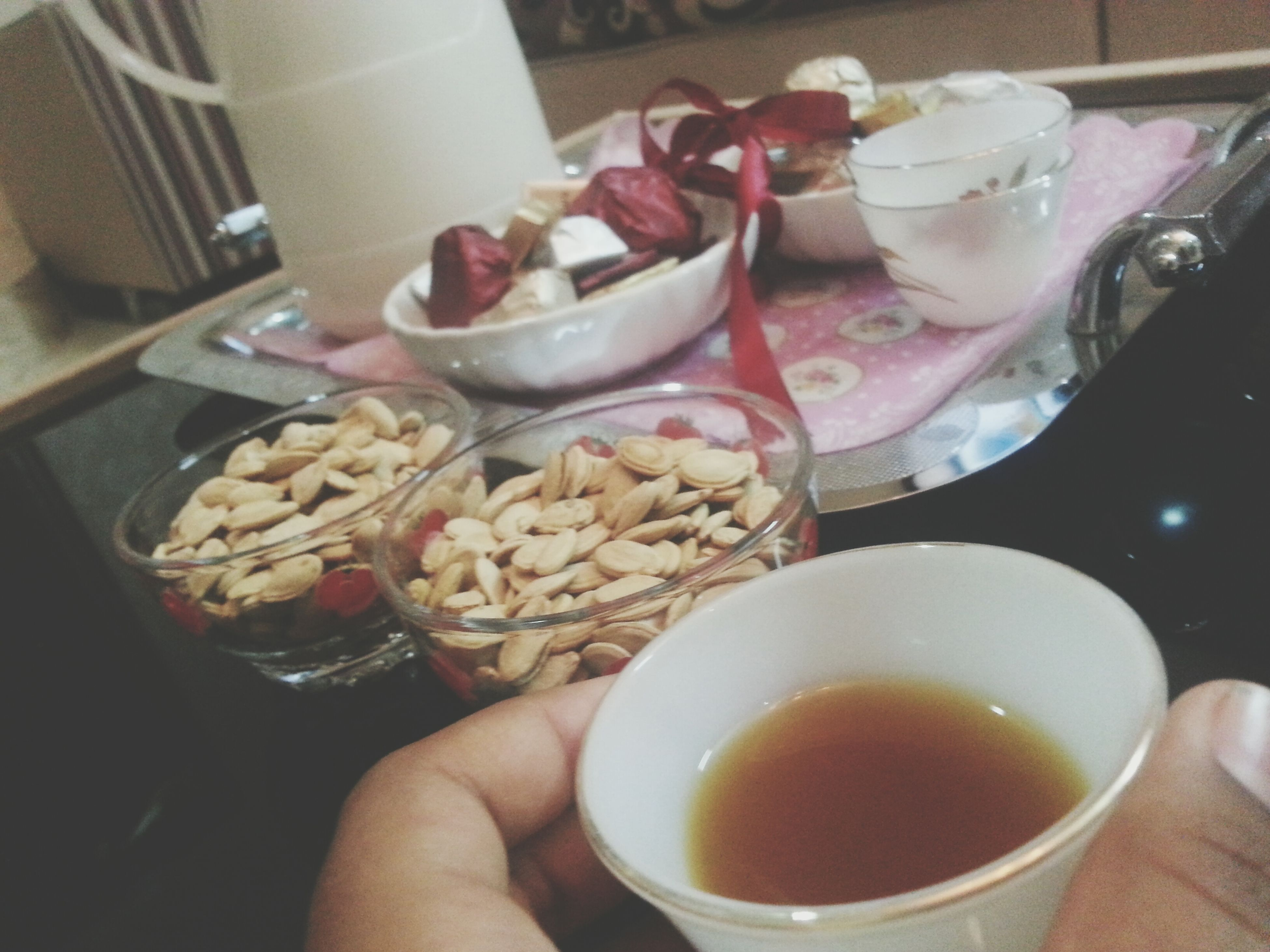 food and drink, indoors, freshness, drink, food, table, plate, refreshment, coffee cup, coffee - drink, ready-to-eat, spoon, person, saucer, breakfast, bowl, high angle view, cup