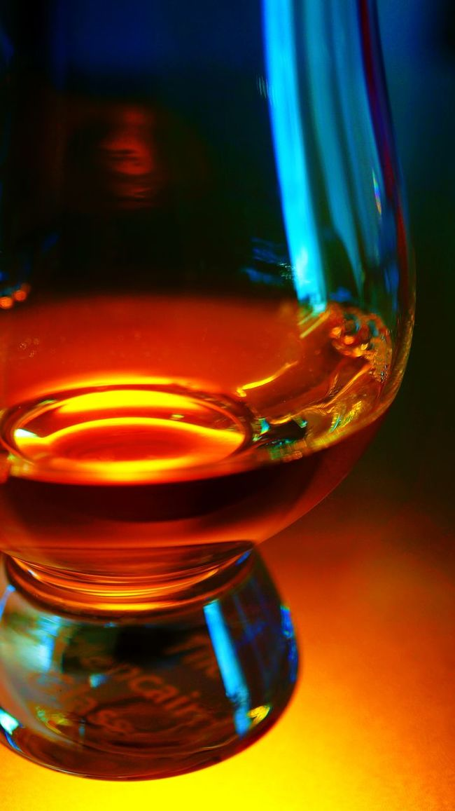 Close-up of single malt whisky in a tasting glass. Alcohol Alcoholic Drink Bourbon Close-up Focus On Foreground Glowing Illuminated Liquor Lit No People Refreshment Selective Focus Single Malt Single Malt Scotch Wisky Single Malt Whisky