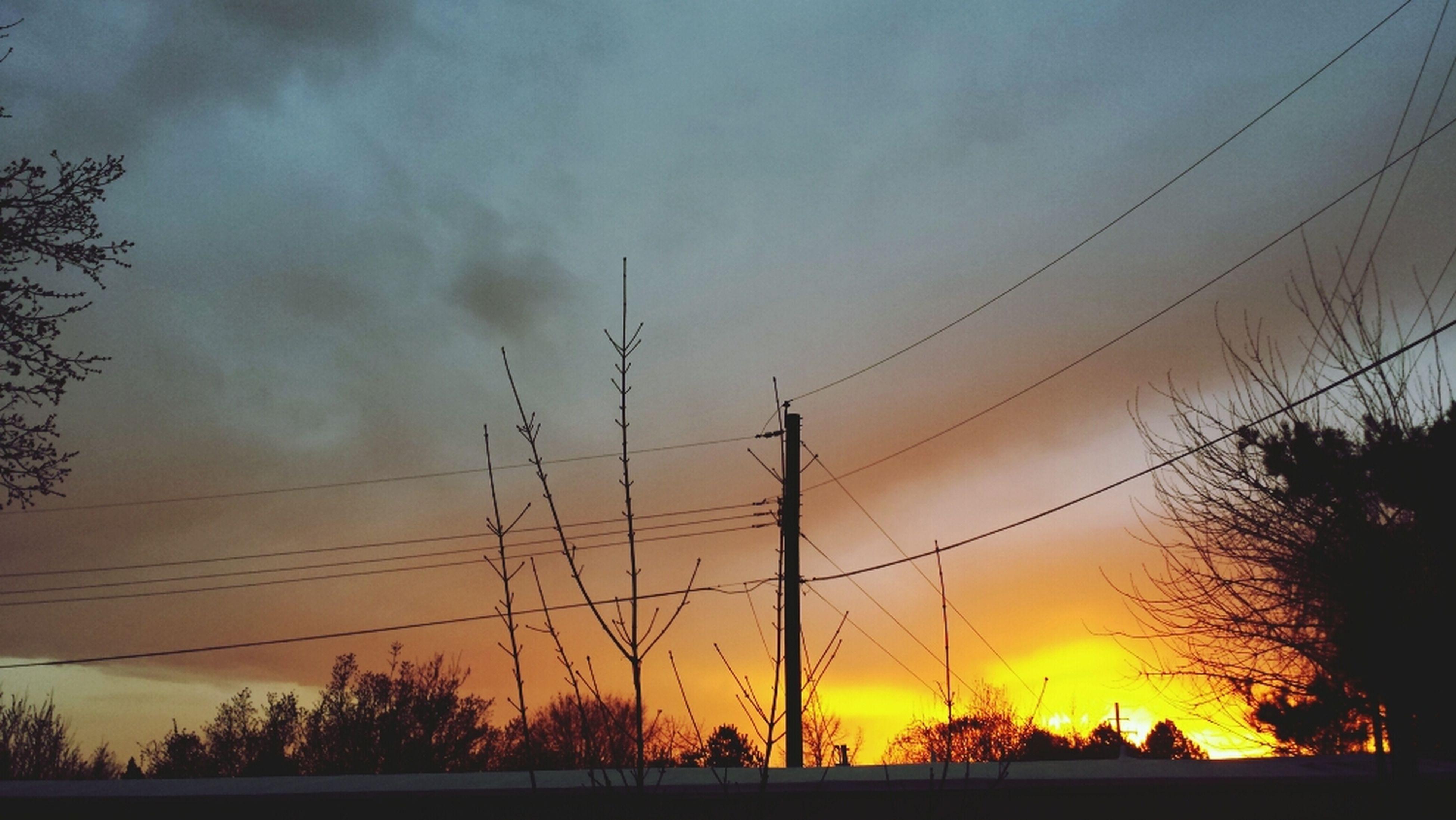 sunset, silhouette, orange color, sky, scenics, beauty in nature, tranquility, tranquil scene, nature, tree, dramatic sky, power line, idyllic, cloud - sky, sun, electricity pylon, moody sky, majestic, cloud, outdoors