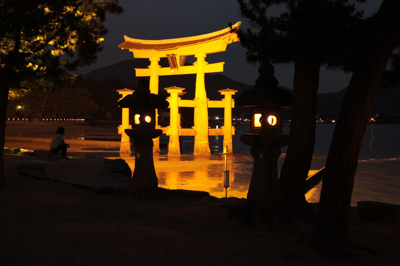 illuminated, built structure, spirituality, night, architecture, no people, silhouette, place of worship, history, ancient, religion, outdoors, statue, sunset, travel destinations, building exterior, tree, nature, sky, ancient civilization