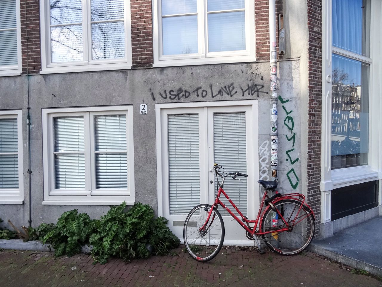 Bicycle Building Exterior Architecture City Outdoors Day No People I Used To Love Her Graffiti Red Bike