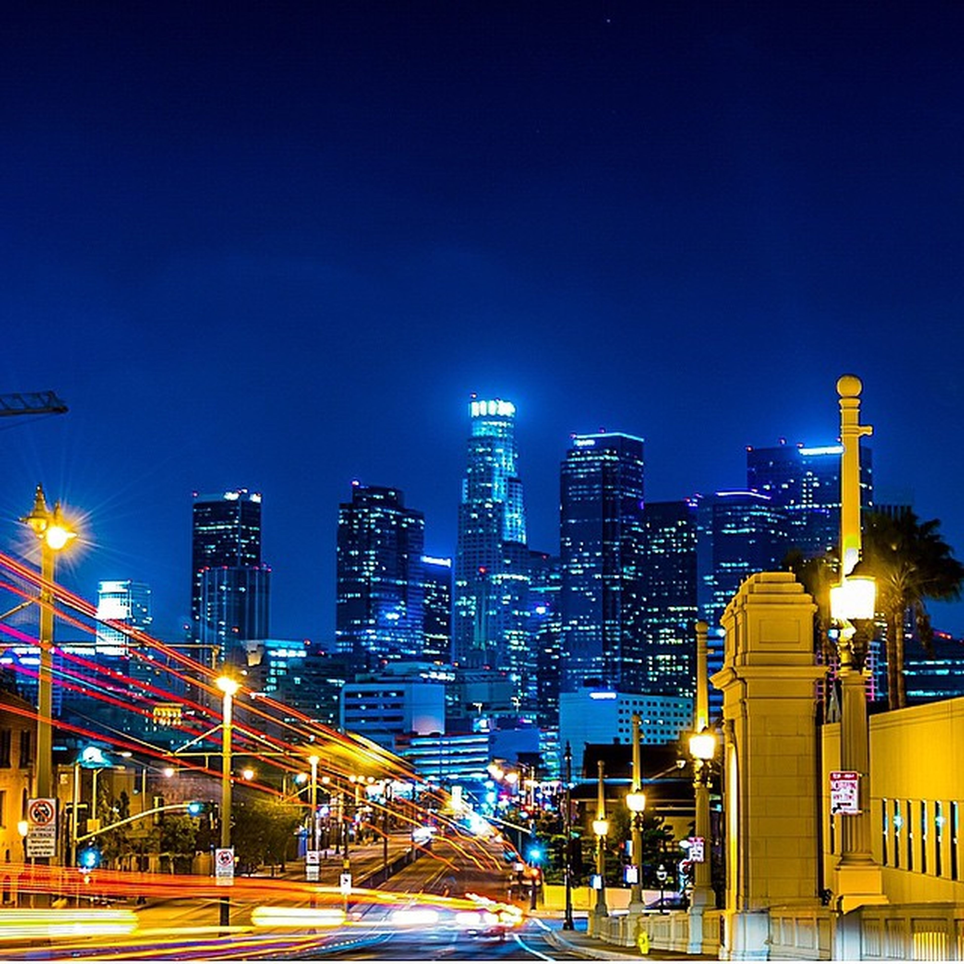 illuminated, building exterior, night, architecture, city, built structure, clear sky, blue, copy space, cityscape, skyscraper, modern, lighting equipment, office building, street light, building, light - natural phenomenon, city life, tall - high, sky