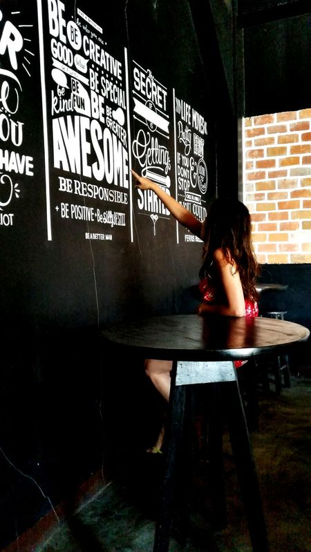 Learn & Shoot: Balancing Elements Random Calligraphy Wall Art Art Black Wall Brick Wall On The Side Lady In Red Dark Hue Black Dark Showcase April Telling Stories Differently