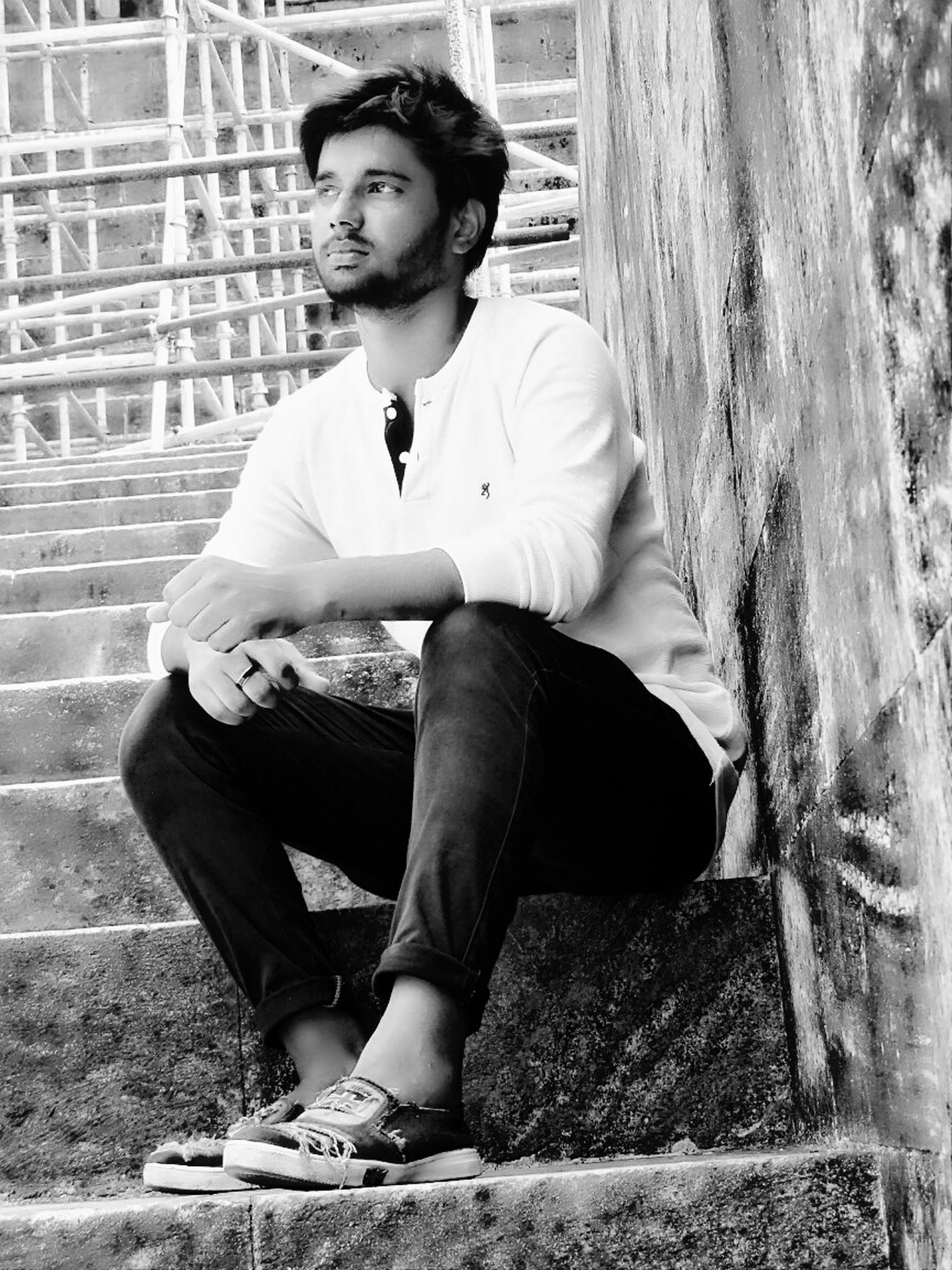 young adult, young men, sitting, one person, real people, full length, casual clothing, front view, lifestyles, portrait, day, handsome, leisure activity, outdoors, looking at camera