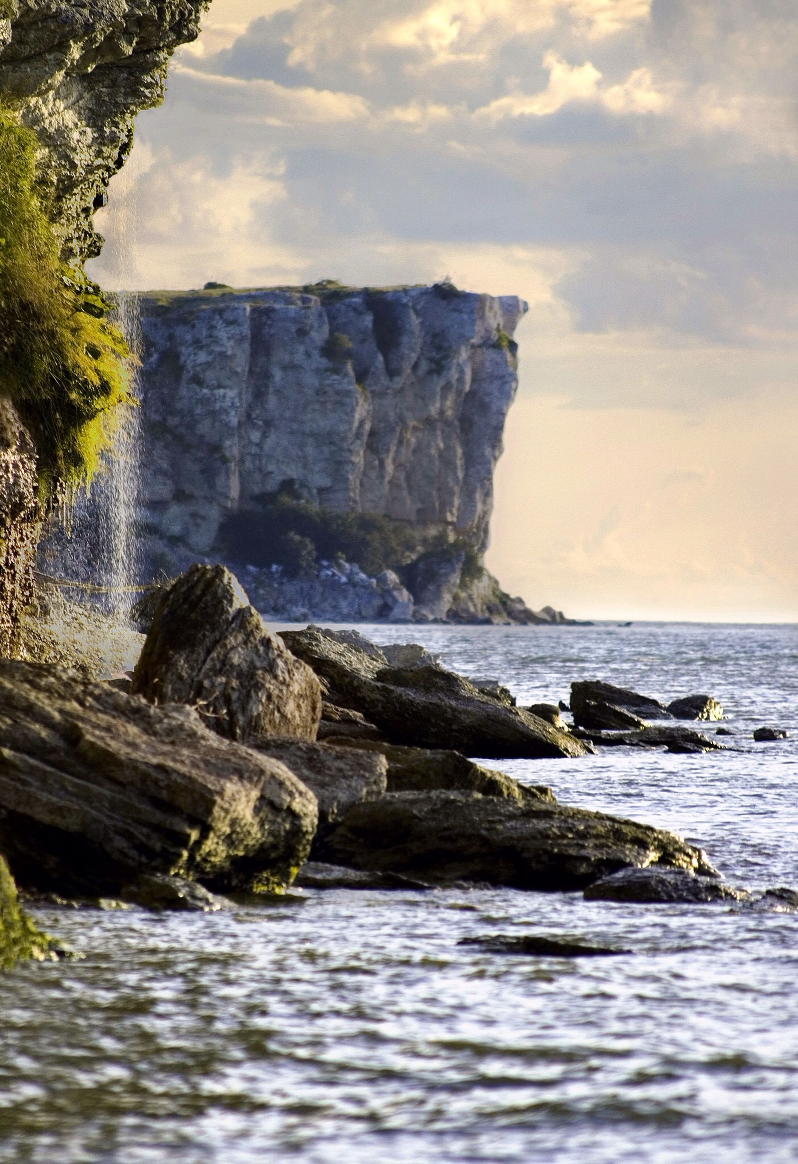 sea, water, rock formation, rock - object, sky, scenics, tranquil scene, tranquility, beauty in nature, horizon over water, rock, nature, waterfront, cliff, idyllic, rippled, cloud - sky, cloud, remote, geology
