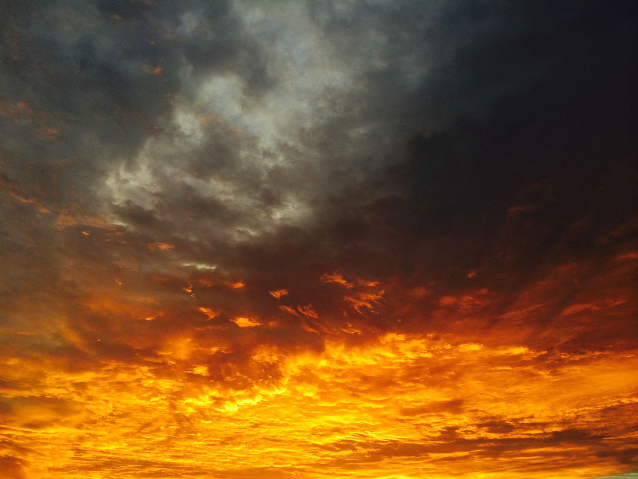 sunset, orange color, dramatic sky, beauty in nature, nature, scenics, sky, yellow, majestic, cloud - sky, tranquility, no people, tranquil scene, low angle view, outdoors, backgrounds, sky only, day