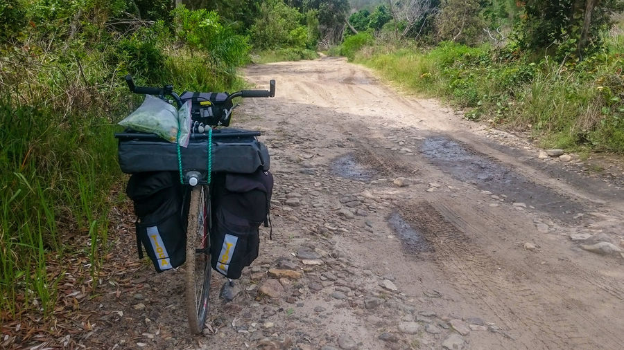 Fully loaded kickbike on dirt road in National Park Bicycle Day Kickbike Narrow National Park Outdoors Panniers Road Transportation
