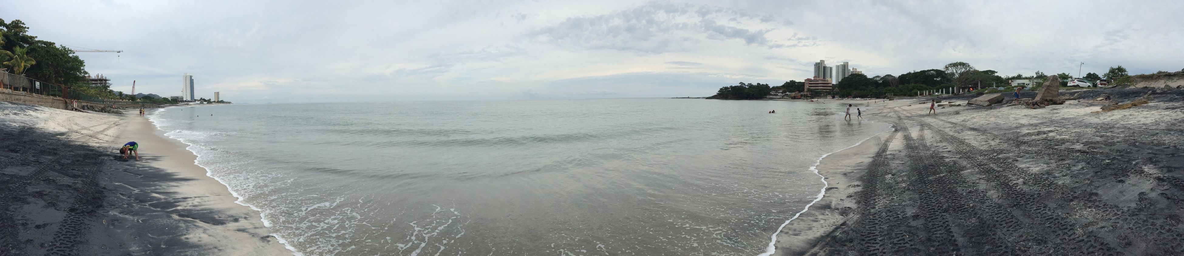panoramic, sea, water, horizon over water, beach, scenics, sky, tranquil scene, incidental people, tranquility, tree, cloud, cloud - sky, beauty in nature, shore, calm, nature, non-urban scene, seascape, coastline, day, outdoors, ocean, waterfront, tourism, cloudy, remote, vacations, tide, no people, long, majestic