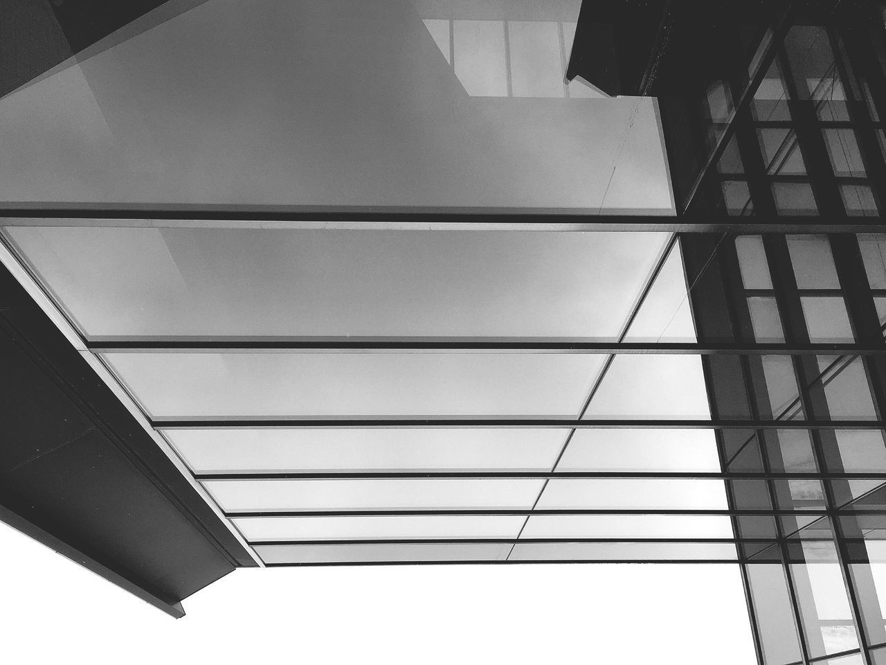 Modern Architecture The Architect - 2017 EyeEm Awards Low Angle View Architecture Built Structure No People Indoors  Day Modern Building Exterior Architecture Modern Architecture Architecture_collection Glass Building Façade EyeEm Best Shots Architectural Detail Architecture_bw Black And White EyeEm Gallery EyeEm IPhoneography Building Architectural Feature Building Story Buildingstyles