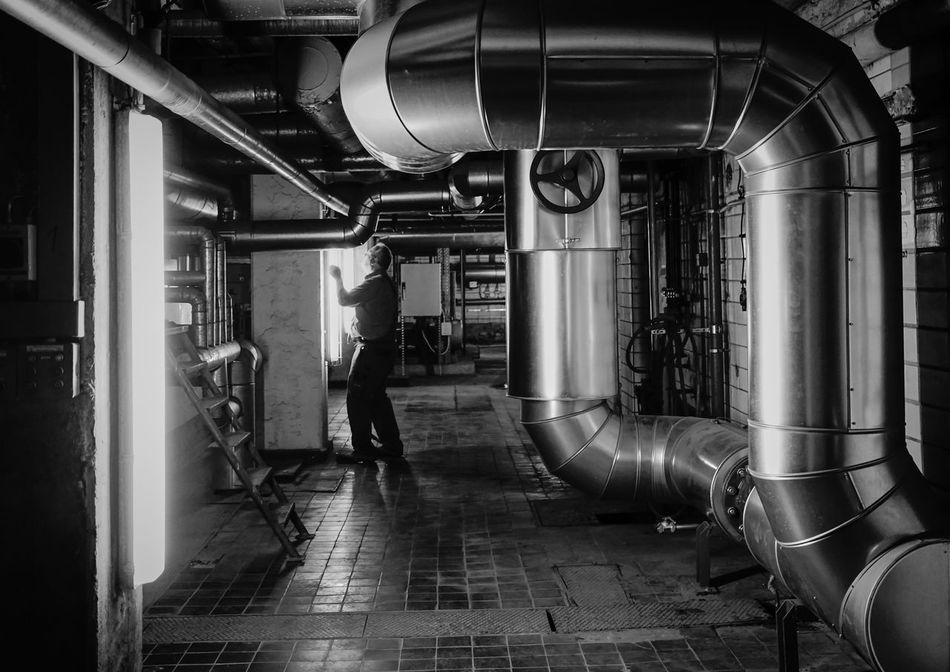 working .... Arbeiten Blackandwhite Construction Enjoying Life Flooring In A Row Indoors  Industry Man Men Metal Pipe Pipe - Tube Repairing Repairs Reparieren Repetition Rohre Side By Side Street Techniker Tiled Floor Urban Worker Working