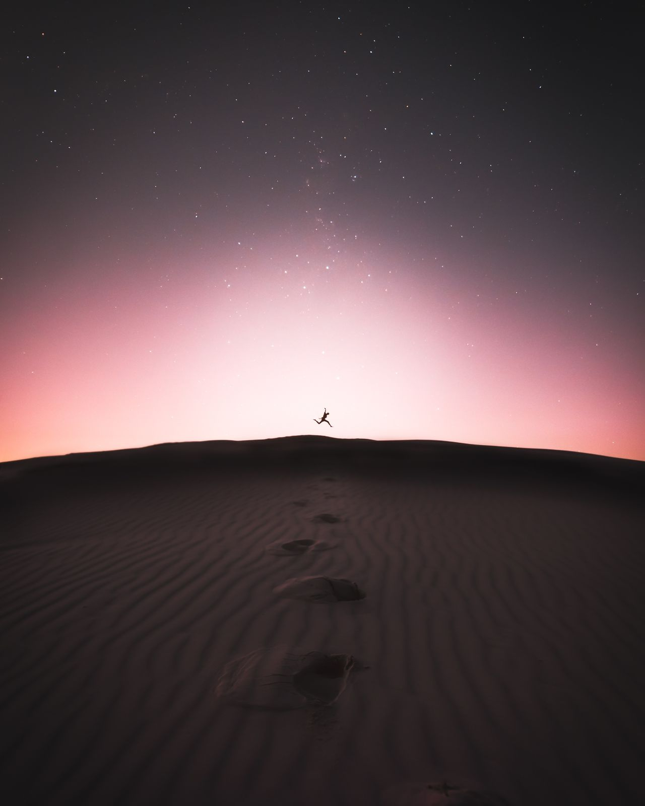 Dont take the things for granted other people are praying for.Silhouette Nature Outdoors Desert Tranquility Beauty In Nature One Person Scenics Sand Dune Astronomy Star - Space Night People Sky Sand Arid Climate Modern Travel Landscape Sunset Calm Nature Minimal Galaxy