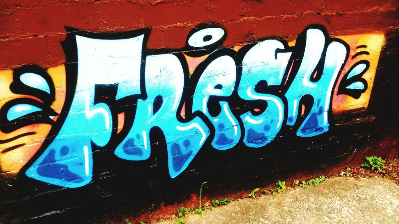 graffiti, text, communication, outdoors, no people, street art, day, paint, multi colored, built structure, architecture, close-up