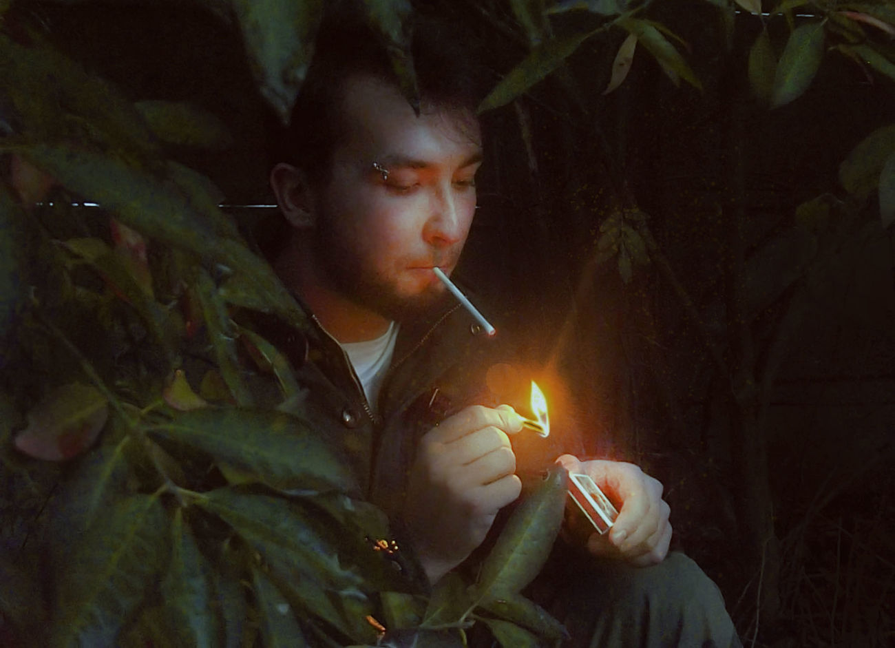 My camera can't doing photos in darkness very well, but I really like atmosphere in this picture. 🙈 Bad Boy  Badboy Boy Burning Casual Clothing Cigarette  Fire - Natural Phenomenon Firework - Man Made Object Flag Flame Flame Light Holding Leaves Lifestyles Light And Shadow Man Nature Outdoors Person Pircing Sitting Outside Smoke Smoker Smoker Face Young Adult