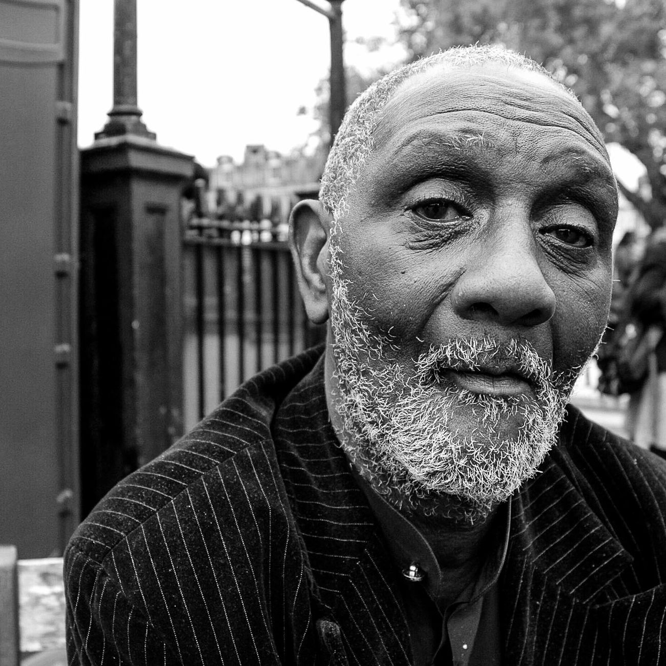 One Man Only Human Face Portrait One Person EyeEm Bnw Close-up City Outdoors Day Streetphotography Melanin Portraits March Cultures Grey Hair Street People Face Urban City Man Sitting Outside Beauty Photooftheday Black & White Blackandwhite