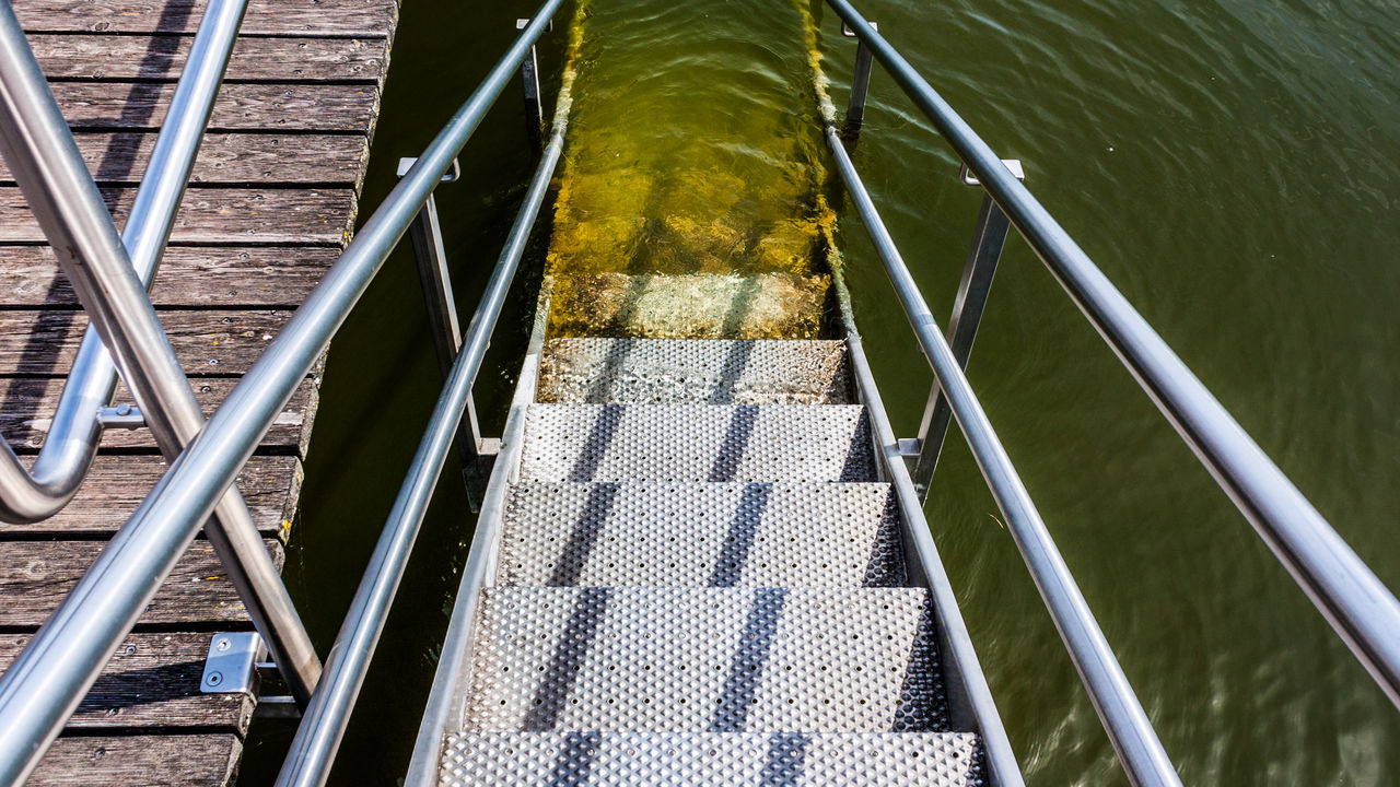 Bathing Chiemsee Day High Angle View Lake Metal Nature No People Outdoors Railing Reflections In The Water Stairs Steps Sunlight Swimming Pier Water Wood - Material