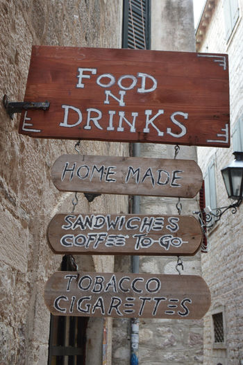 Old Town Sendwhich Sign Architecture Building Exterior City Close-up Coffee To Go Communication Food And Drink Industry Guidance No People Outdoors Restaurant Restaurant Sign Road Sign Rustic Sign Rustic Style Tabacco  Text Wood Board Wood Sign