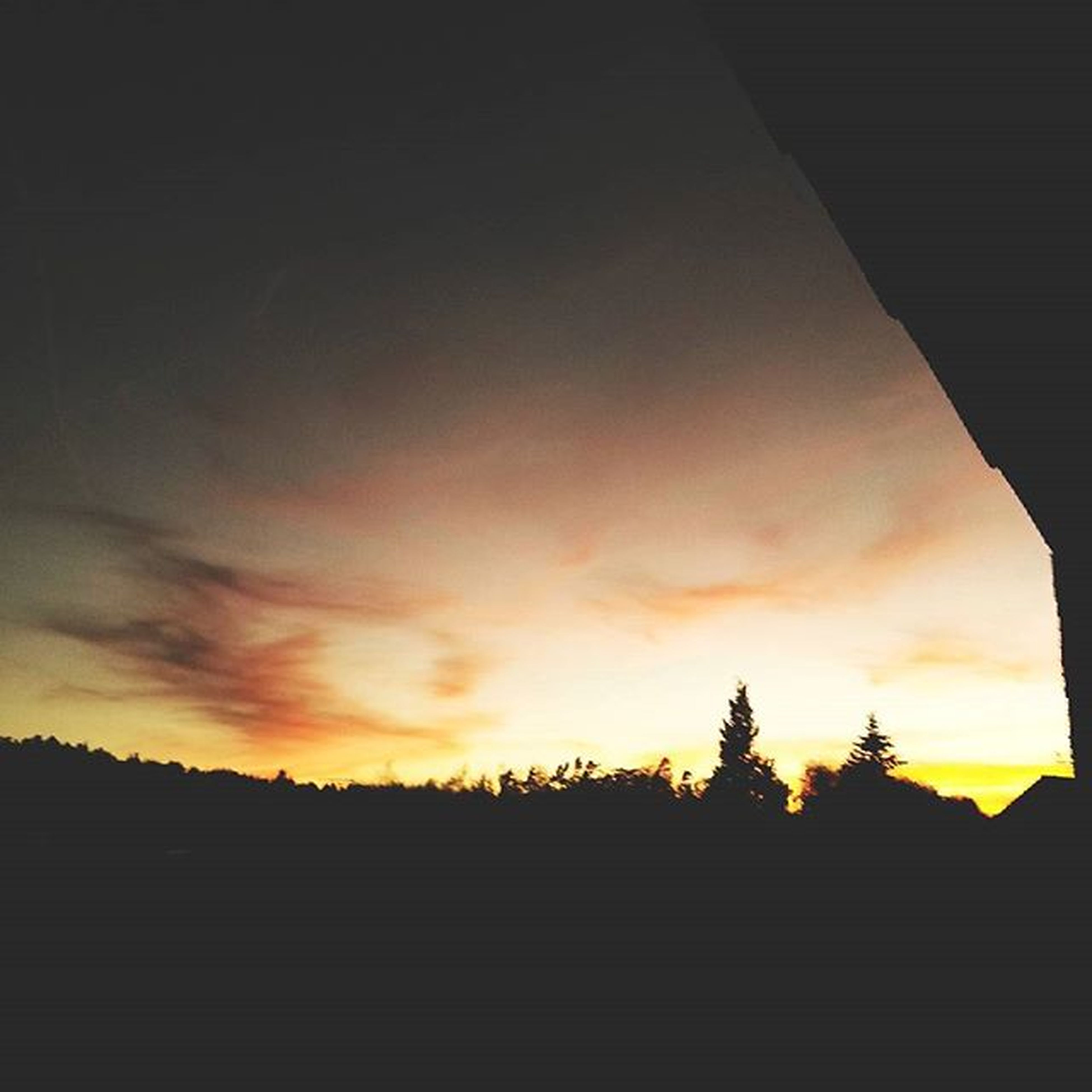 sunset, silhouette, sky, orange color, built structure, architecture, building exterior, cloud - sky, beauty in nature, low angle view, scenics, nature, cloud, tranquility, tranquil scene, dramatic sky, house, outdoors, no people, idyllic