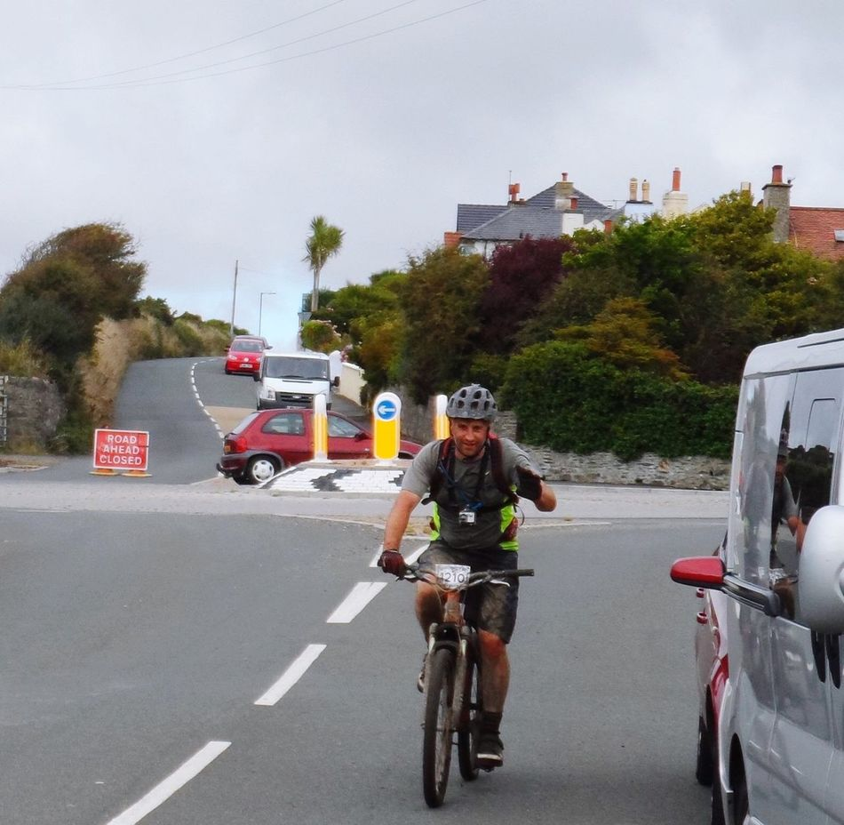 Adventure Club photo taken while hanging out of car window while traveling during IOM End to End challenge Mountain Biking Cycling Bycicle Bike Race Bike Ride