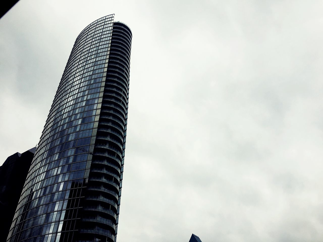 architecture, modern, building exterior, skyscraper, built structure, low angle view, sky, tower, city, outdoors, day, no people, cloud - sky, travel destinations, corporate business, tall, office park