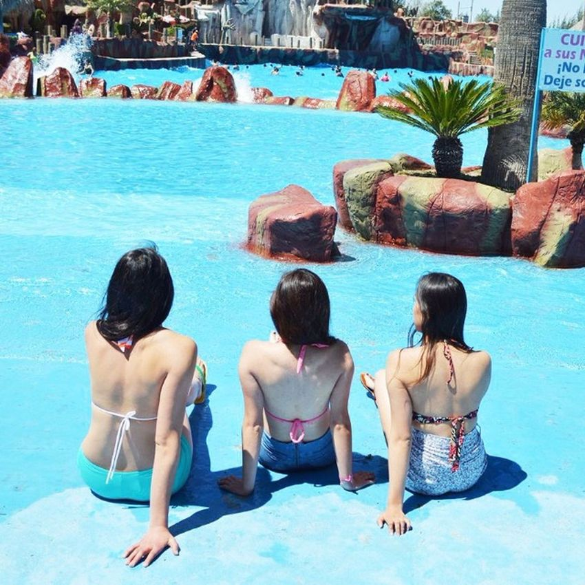 Waves Thermal Water Vacation Time Pool Pool View Photography Tranquility Friendship Women Pool Water Blue Wave Blue Sky Tranquil Scene Blue Color People Back People Photography People And Places Pool Day  Pool Side Pool Of Water Sunny Da Photograph Of Backs