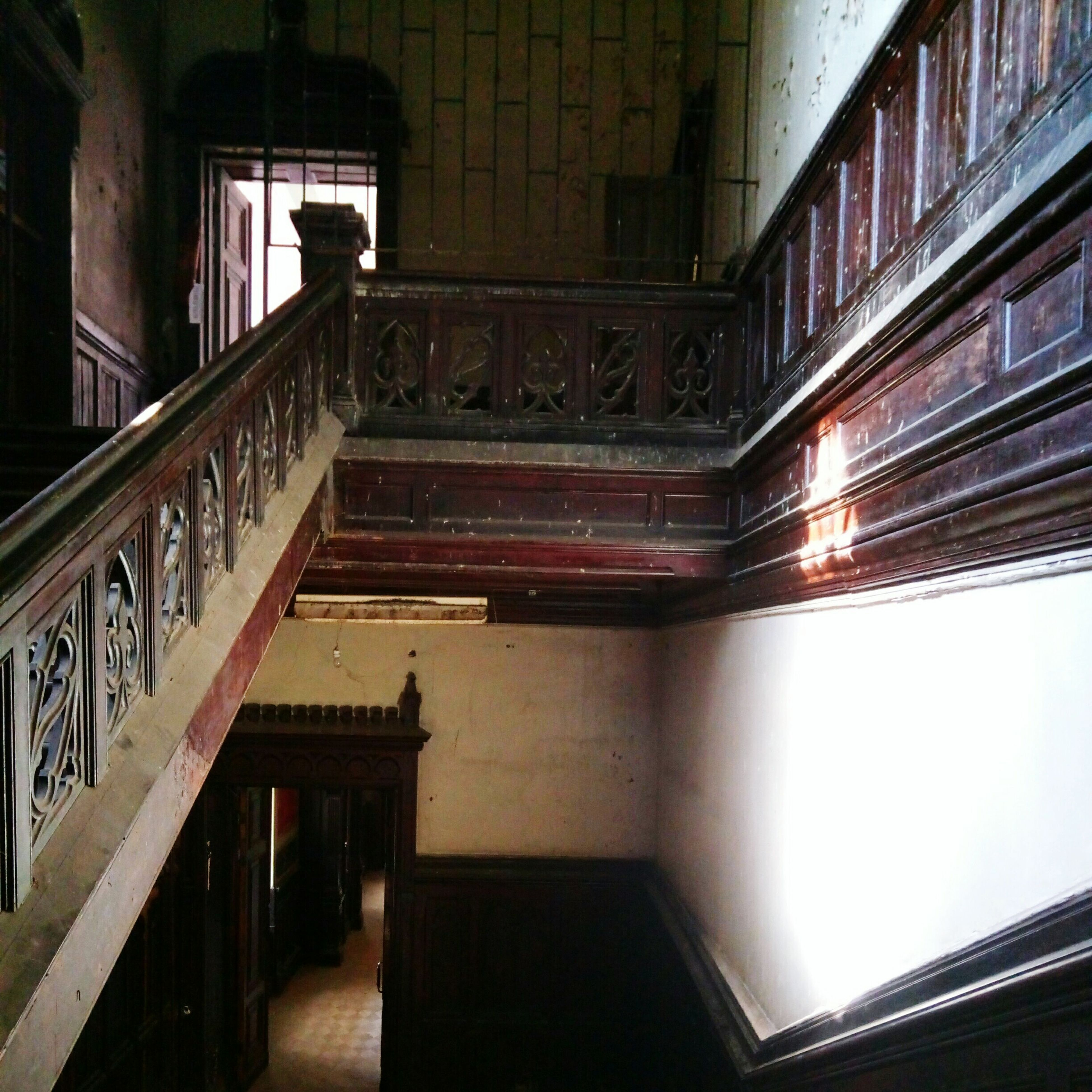 railing, indoors, staircase, architecture, steps and staircases, built structure, steps, no people, day