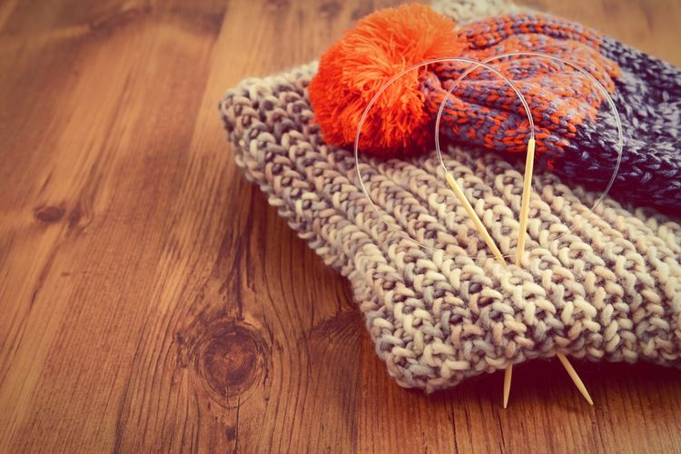wooly hat and scarf. knitting needles on wooden table. Knitting Wear Handmade Crafts Handmade Wool Knitt Knitting Wool Knitting Knitted  Knitting Project Handcrafted Knitting Needle Scarf Season Scarf Wool Hat Wool Balls Hats Wooly