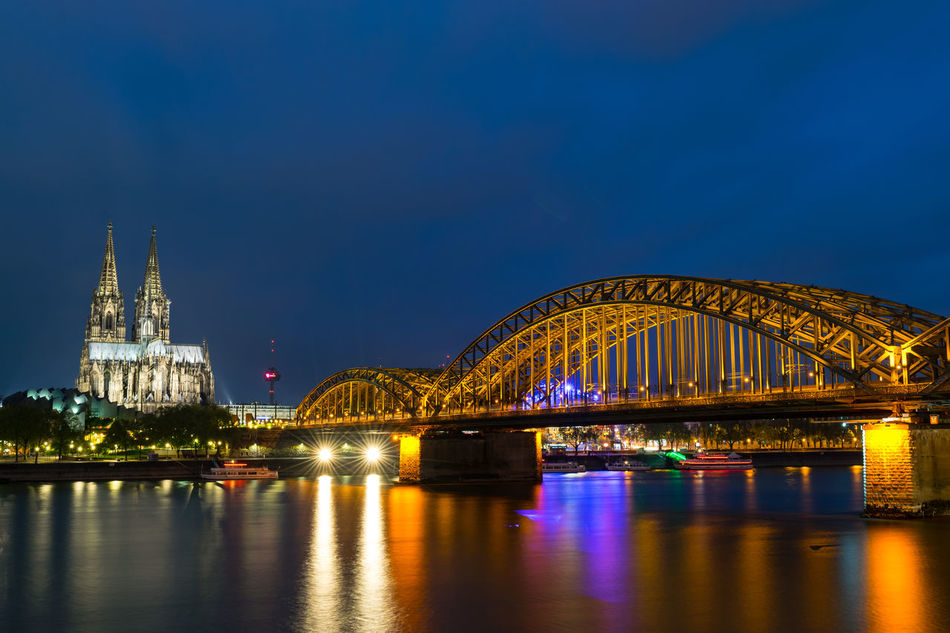 """Cologne by night: """"Hohenzollernbrücke"""" and Cathedral Bridge Cathedral EyeEm Best Shots Illuminated Night River Sky Travel Destinations Water Water Reflections"""