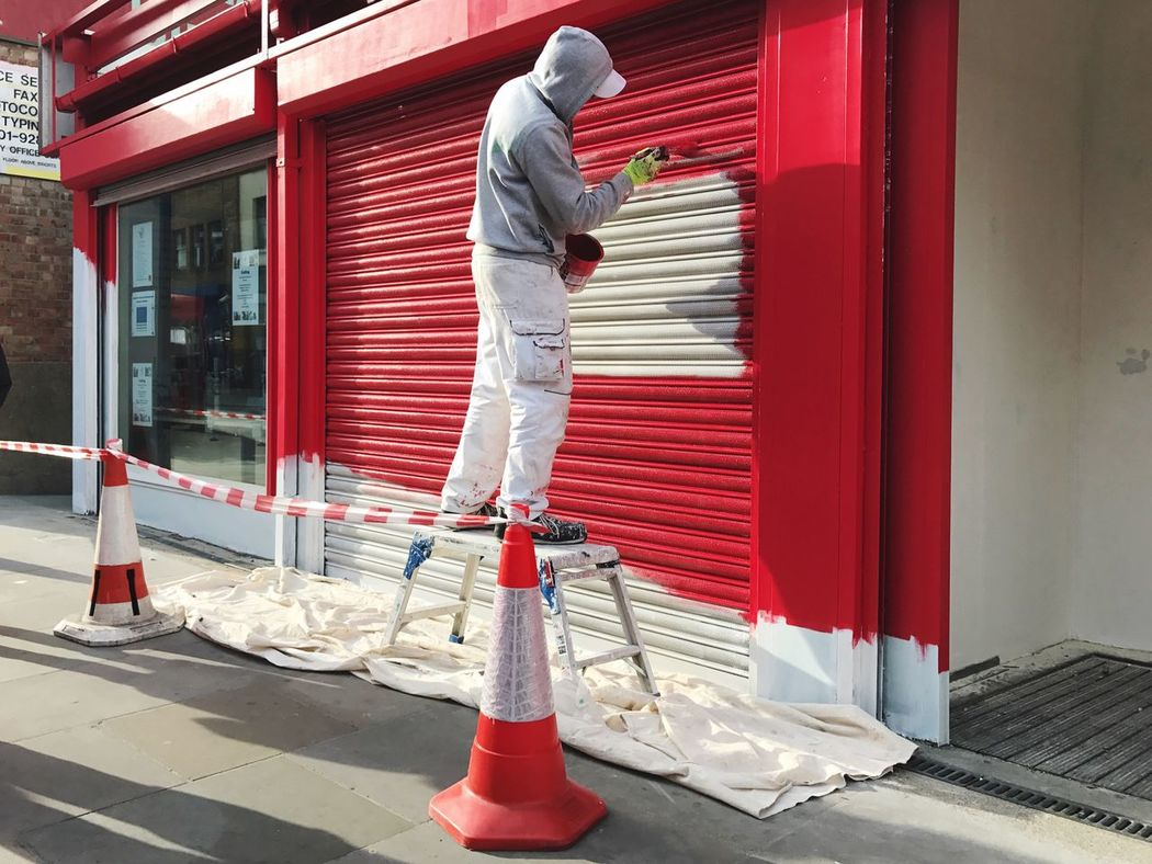 Full Length Safety Protection Men One Person Protective Workwear Built Structure Red Outdoors Working Day Architecture Building Exterior Real People One Man Only Only Men Occupational Safety And Health Adult People London Job Painting Worker