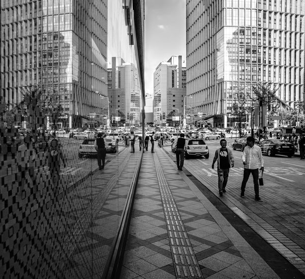Asia, Korea, Seoul, Streets, Markets people and sights Architecture Building Exterior Car City City Life City Street Incidental People Land Vehicle Leading Narrow Road Sidewalk Street The Way Forward Transportation Urban Walking Women Seoul, Korea B&w Street Photography
