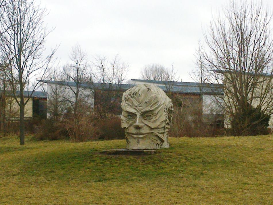 Human Representation Tree Sky No People Statue Sculpture Bare Tree Outdoors Grass Day Nature Modern Art Man Made Object Erlangen Face Sculpture Face Smiles ;)