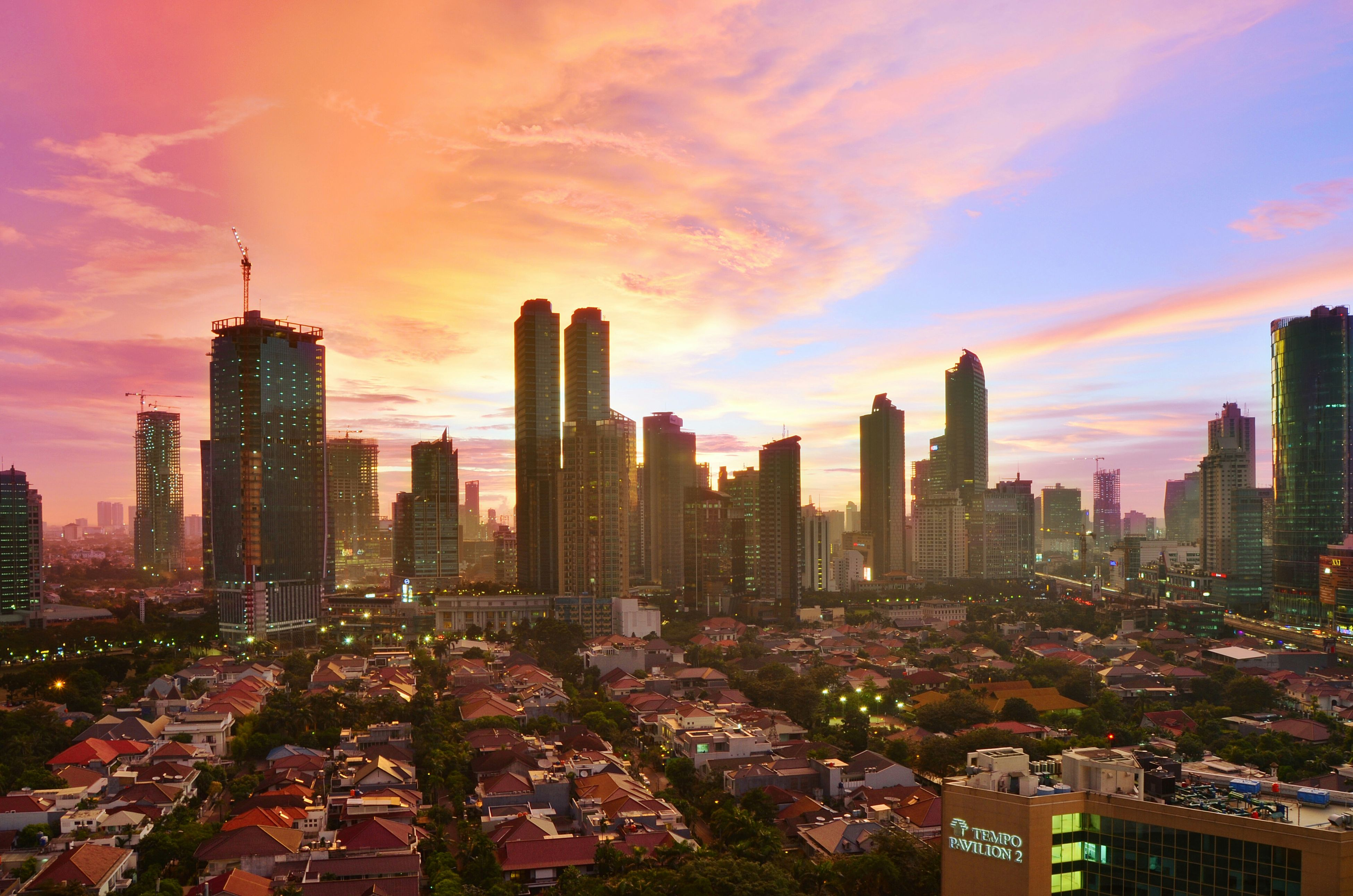 city, building exterior, cityscape, architecture, built structure, skyscraper, sunset, sky, high angle view, tall - high, tower, crowded, urban skyline, modern, orange color, cloud - sky, city life, office building, residential district, residential building