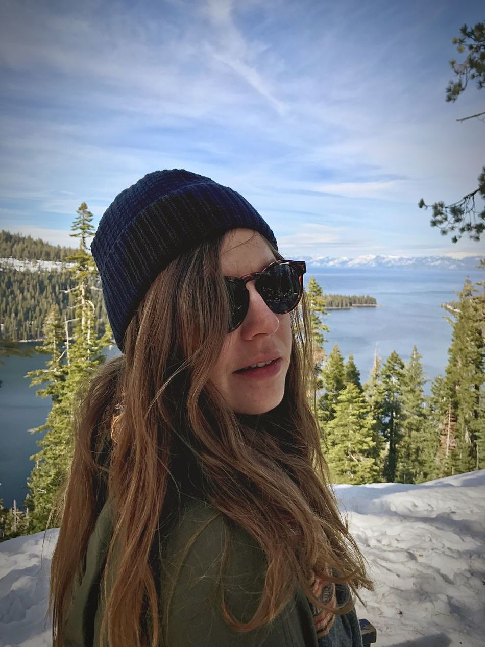 Roadtrip Sunglasses One Person Long Hair Sky Leisure Activity Day Real People Lifestyles Young Women Young Adult Portrait Smiling Outdoors Nature Looking At Camera Tree Water Warm Clothing People