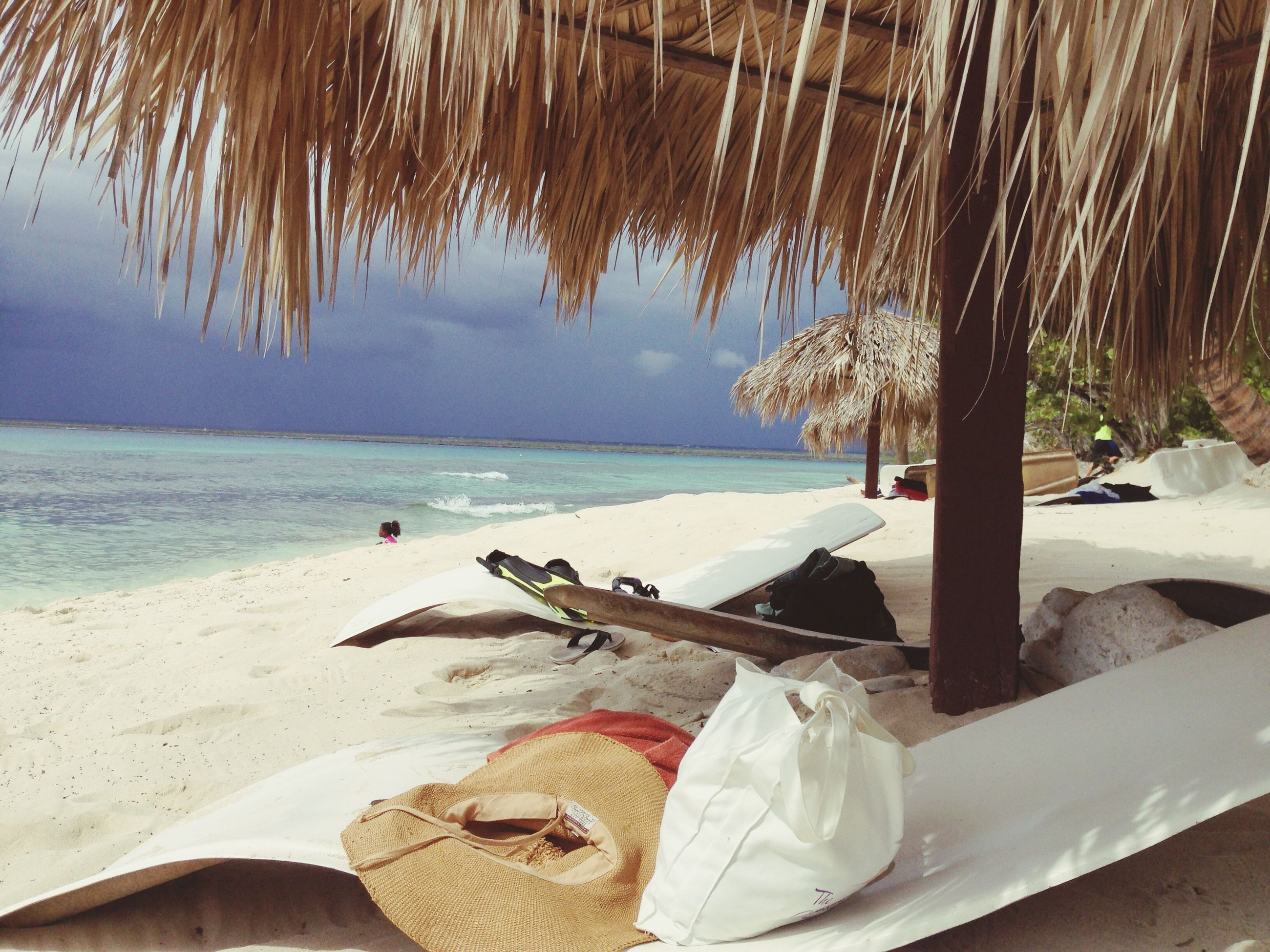 beach, sea, sand, shore, horizon over water, water, tranquility, tranquil scene, nature, chair, relaxation, sky, wood - material, lounge chair, sunlight, beauty in nature, vacations, day, scenics, deck chair
